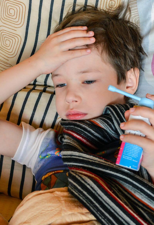 Young boy holding aesthma inhaler