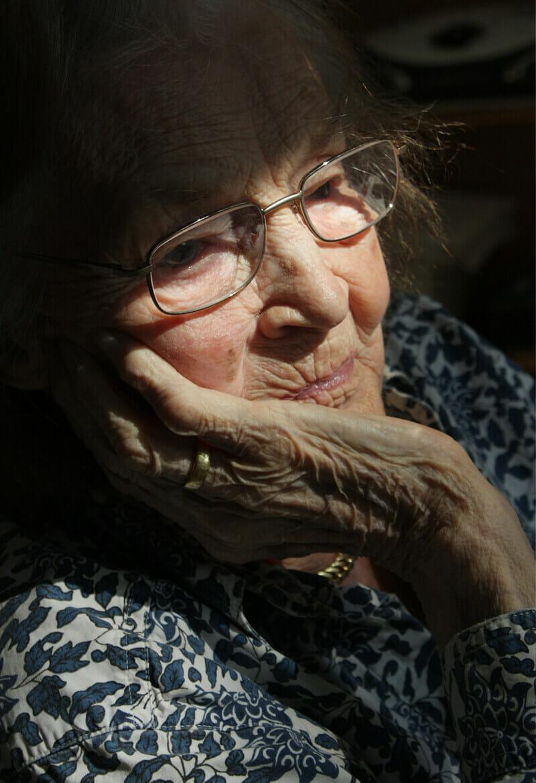 Elderly woman reflecting